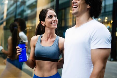 Couple jogging and running outdoors in city Zdjęcie Seryjne