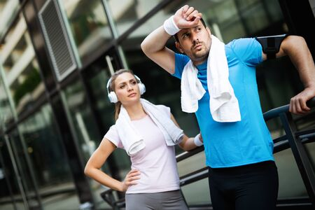 Exhausted fit couple runners after fitness running workout outdoors Zdjęcie Seryjne