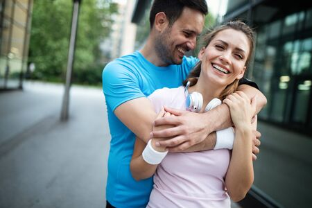 Sporty happy couple exercising together. Sport concept