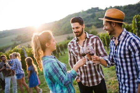 Wine grower family in vineyard having fun time Stock Photo