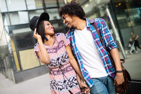 Happy young black couple hugging and laughing outdoors. Фото со стока - 129809758