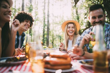 Group of friends having barbecue party in nature Stock Photo