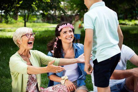 Happy family enjoying picnic in nature at summer 版權商用圖片