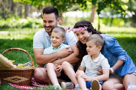 Cheerful happy family picnicking on a beautiful day Stock fotó - 129828392
