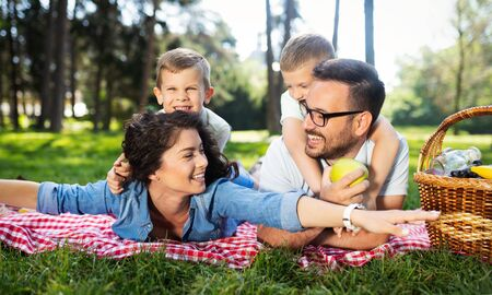 Young family with children having fun in nature Stock fotó - 129828406