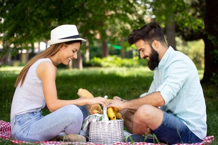 Couple in love enjoying picnic time outdoors Stock Photo - 129828525
