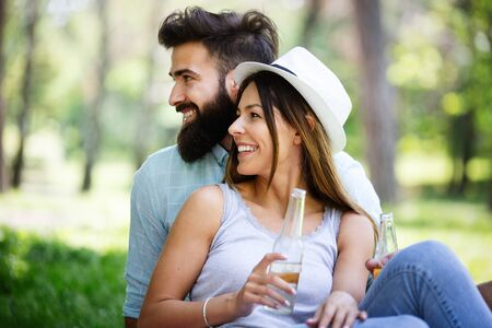 Couple in love enjoying picnic time outdoors Stock Photo