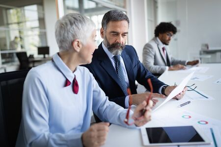 Group of happy business people working in a meeting at office Stock Photo