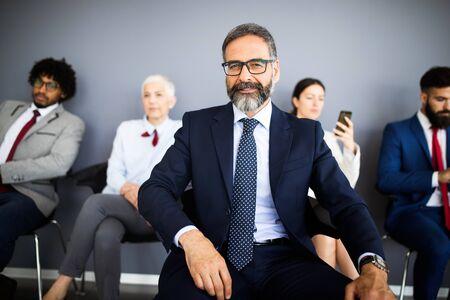 Portrait of senior businessman as leader at modern bright office interior