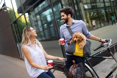 Romantic couple is having rest in the city with dog and bicycles Фото со стока