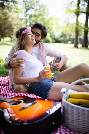 Beautiful young couple enjoying in a good mood and picnic day Stock Photo