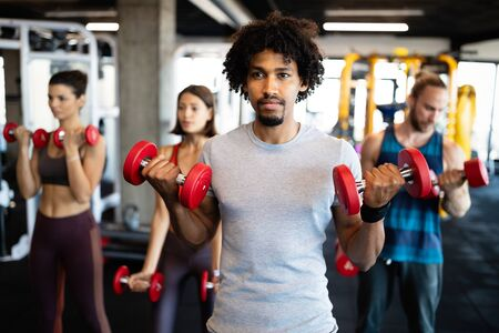 Fitness, sport, training and lifestyle concept. Group of people exercising in gym Reklamní fotografie