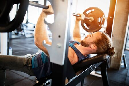 Young fit man working out in the gym Stok Fotoğraf