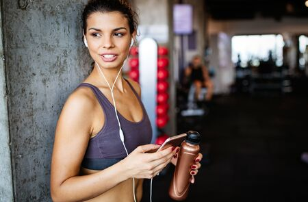 Beautiful fit women working out in gym