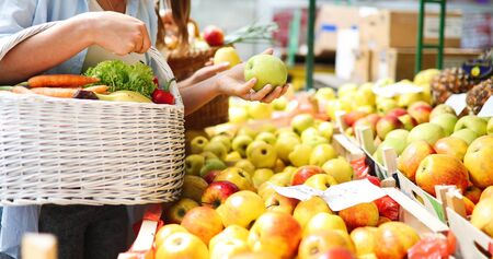 Young woman shopping healthy food on the market