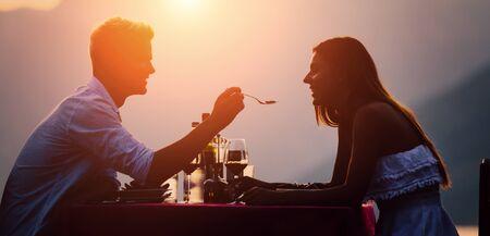 Young couple have romantic evening on sea beach Archivio Fotografico