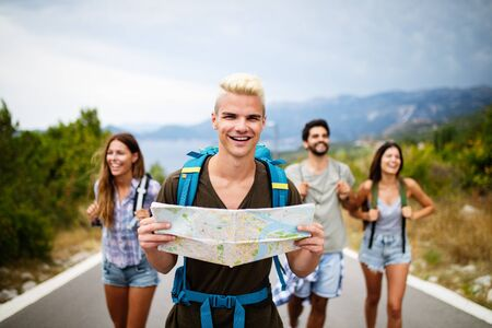 Group of happy friend traveler walking and having fun. Travel lifestyle and vacation concept Imagens