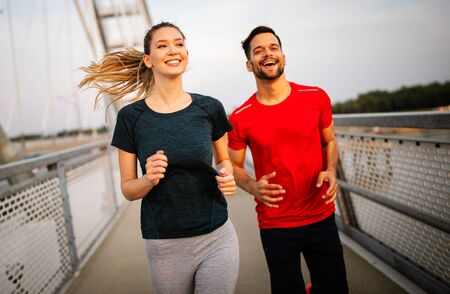 Healthy sporty young people jogging and running outdoors Stock Photo