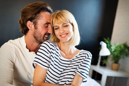 Couple in love hugging and bonding with true emotions at home