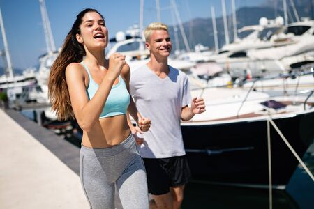 Couple jogging and running outdoors in nature. Sport concept