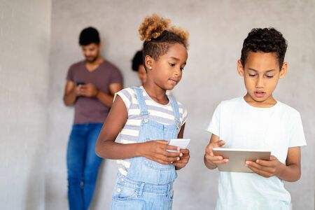 Modern children using mobile devices, tablet, smartphone. Technology concept.