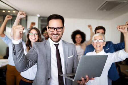 Successful team of young perspective businesspeople in office Stock Photo