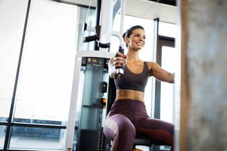 Attractive young woman working out at a gym.