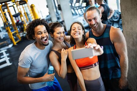 Group of friends having fun at the gym, making a selfie Stockfoto - 135490446
