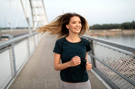 Sport, health, lifestyle and exercise concept. Sporty fit woman running.