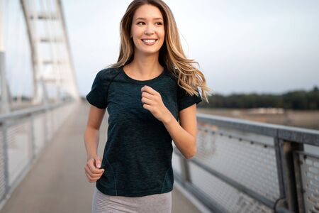 Sporty woman jogging in city to keep her body and soul in shape Reklamní fotografie