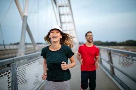 Healthy sporty young people jogging and running outdoors Reklamní fotografie