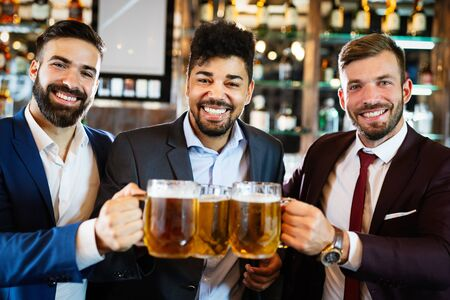Group of happy friends drinking beer at the pub and having fun Standard-Bild - 139596879