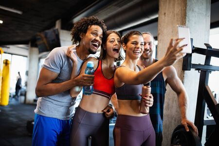 Friends making selfie in the gym after workout Standard-Bild - 139596806