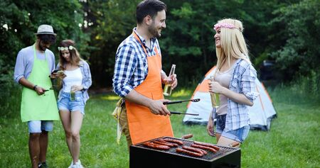 Friends enjoying bbq party Standard-Bild - 140185883