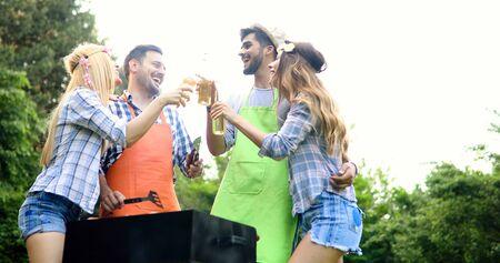 Happy friends enjoying barbecue party Standard-Bild