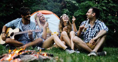 Friends having bonfire party anf fun together Standard-Bild - 140189653