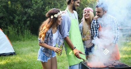 group of friends having outdoor garden barbecue Standard-Bild - 140192104