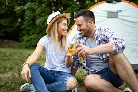 Young couple in tent camp on summer outdoor