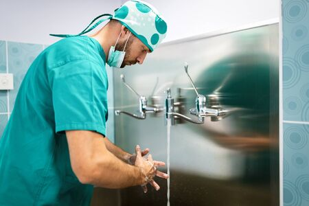 Surgeon washing hands to operation using correct technique for cleanliness in hospital