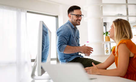 Happy young couple working at home office