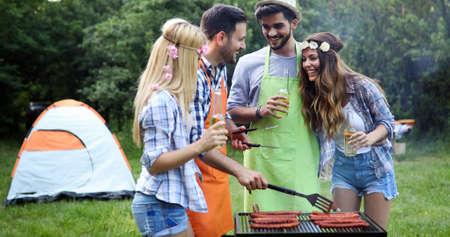 Happy people having camping and having bbq party 版權商用圖片
