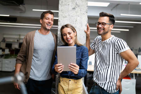Happy creative designers, business people brainstorming in office