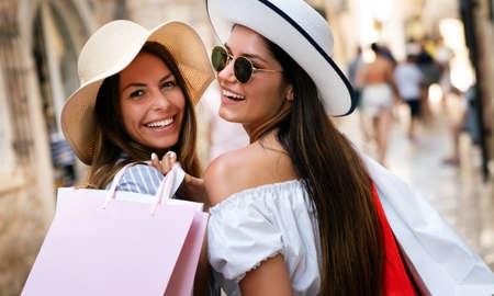 Beautiful shopping women friends happy holding shopping bag