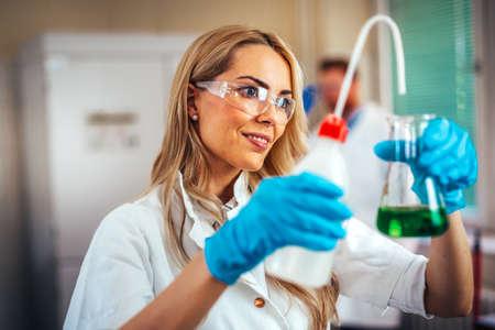 Attractive young woman scientist working in laboratory Zdjęcie Seryjne