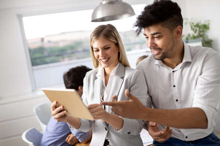 Cheerful coworkers in office during company meeting Stock fotó