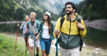 Group of fit healthy friends trekking in the mountains 版權商用圖片 - 157341349
