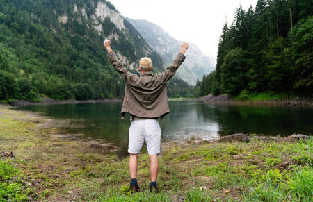 Happy hiker winning reaching life goal, success, freedom and happiness, achievement in mountains. 版權商用圖片