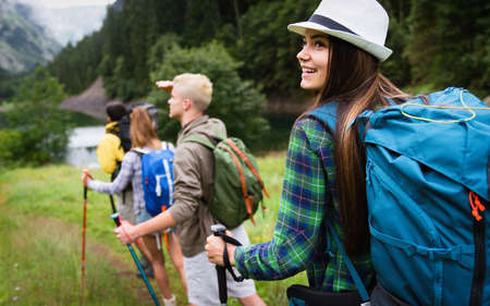 Group of happy hiker friends trekking as part of healthy lifestyle outdoors activity 版權商用圖片