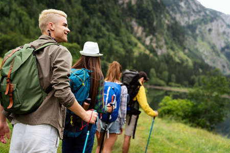 Group of happy hiker friends trekking as part of healthy lifestyle outdoors activity 版權商用圖片 - 157341960