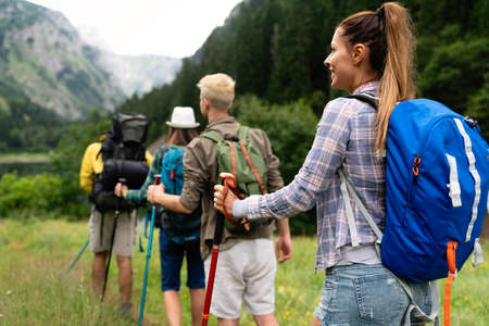 Adventure, travel, tourism, hike and people concept. Group of happy friends with backpack outdoors 版權商用圖片 - 157342657